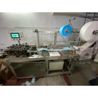 FULLY AUTOMATIC MASK MAKING MACHINE WITH AUTOMATIC LOOPING ATTACHMENT DUEL LOOP SEAL